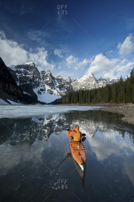 Man Kayaking In Moraine Lake In Winter Banff National Park