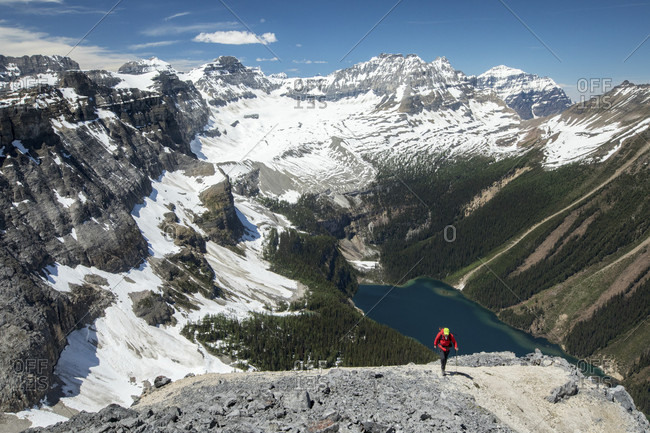 View of lake and snow covered mountains from Boom Mountain, Kootenay National Park, British Columbia, Canada