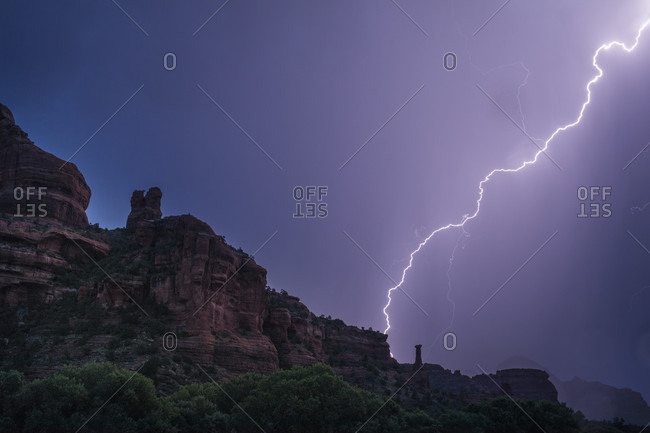 Lightning above rock formations during monsoon, Sedona, Arizona, USA