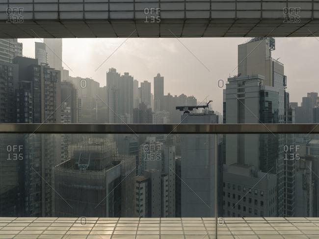 Hong Kong, People's Republic of China - March 18, 2018: Hong Kong city skyline view through balcony opening