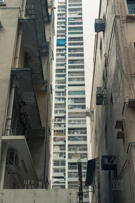 Low angle view between buildings of Hong Kong housing complex