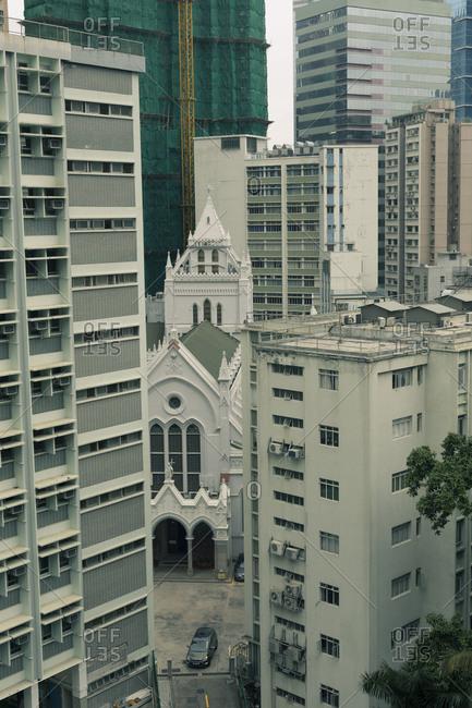 Hong Kong, People's Republic of China - March 18, 2018: View of church between buildings in Hong Kong