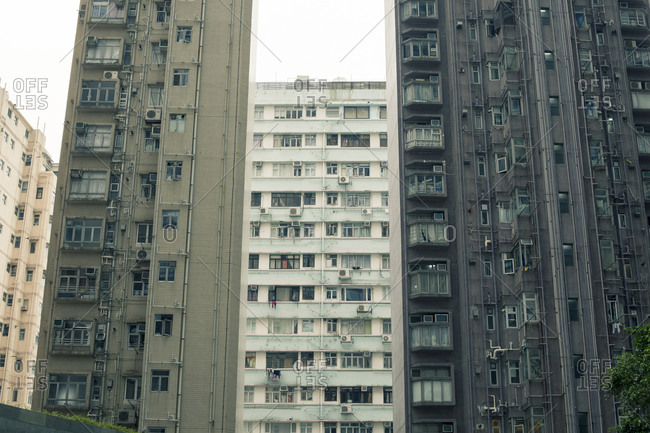 Hong Kong, People's Republic of China - March 18, 2018: Apartment complex exterior walls with balconies in Hong Kong