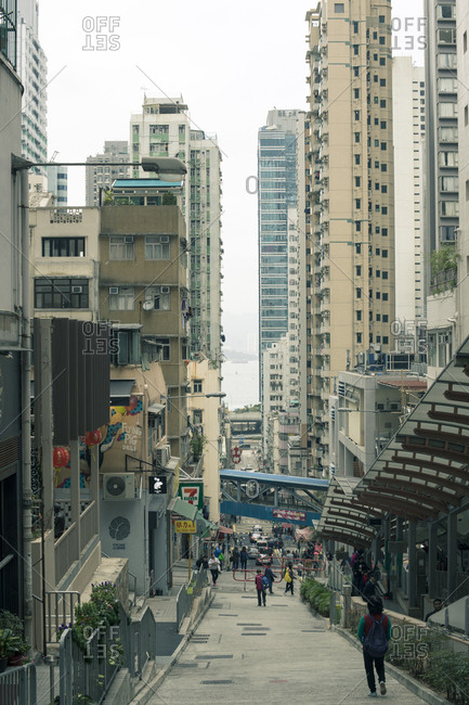 Hong Kong, People's Republic of China - March 18, 2018: View down narrow Hong Kong city street
