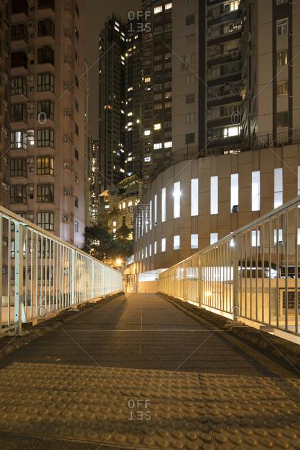 Hong Kong, People's Republic of China - March 18, 2018: Urban sidewalk bridge in Hong Kong neighborhood