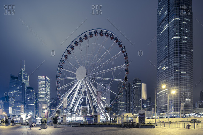 Hong Kong, People's Republic of China - March 18, 2018: Empty amusement ride lot  in front of night city skyline