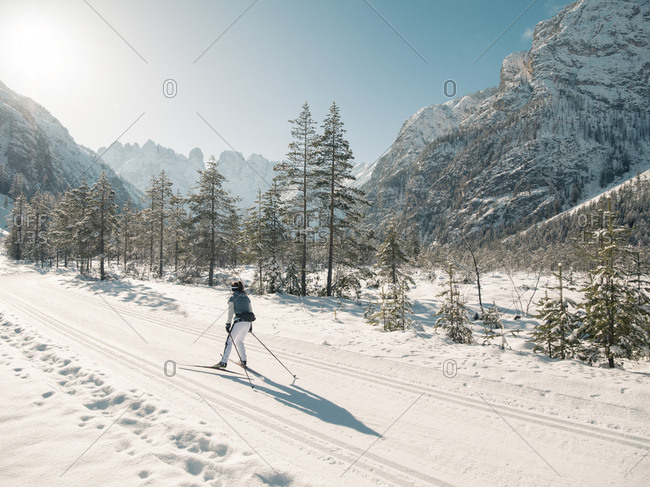 Scenic mountain view of woman skiing in mountainside