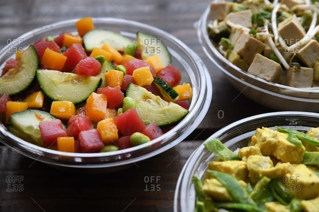 Poke bowls with tuna and tofu filled with fresh fruits and vegetables