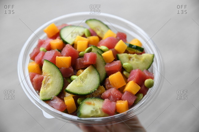 Poke bowl with fresh, raw tuna and fruits and vegetables