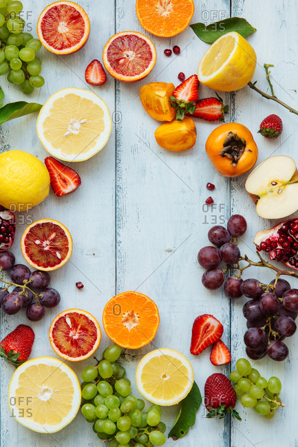Miscellaneous fruit spread around painted wood counter
