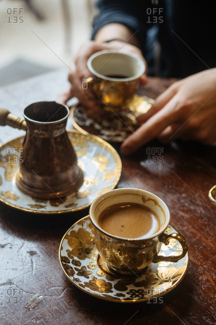 Fresh coffee in ornate drinkware