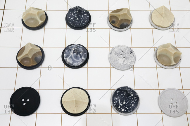 Giant decorative buttons laid out on the floor