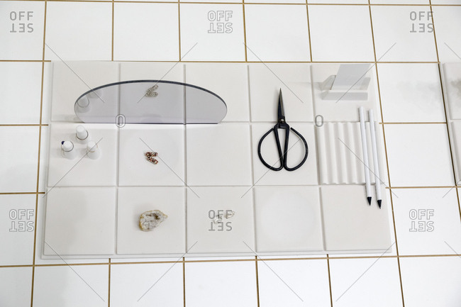 Overhead view of vintage organizer with personal objects