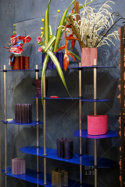 Contemporary shelving unit with many colorful vases