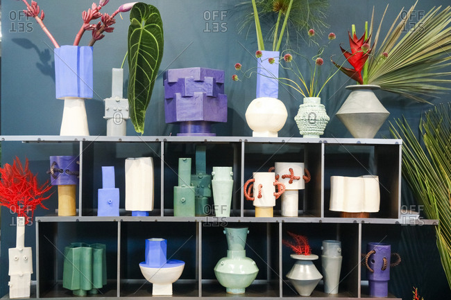 New York City, USA - March 22, 2018: Front view of shelving unit containing many different shapes and colors of vases