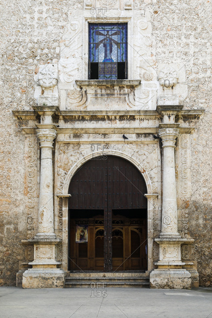 Merida, Mexico - March 02, 2018: View of the grand arch at the entrance of Cathedral in Merida, Mexico