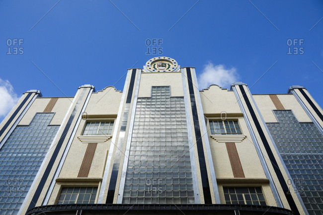 Looking up at Art Deco facade of movie theatre in Merida, Mexico