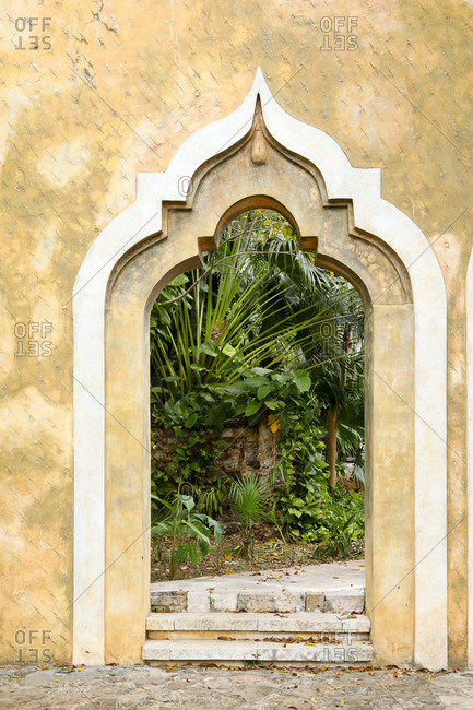 View of Moorish archway leading into garden of estate