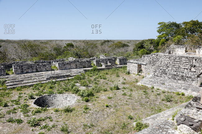 A view of a well and courtyard in the ancient ruins of Ek Balam, Mexico