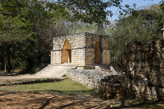 View of defensive wall and entrance arch in the ancient ruins of Ek Balam, Mexico