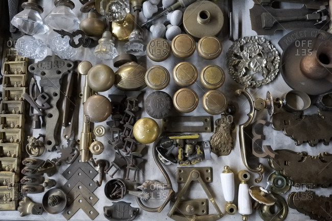 New York City, USA - March 17, 2018: Overhead view of table covered in old fixtures and fittings at Museum of Trash