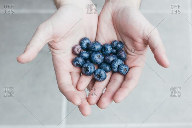 Handful of ripe blueberry