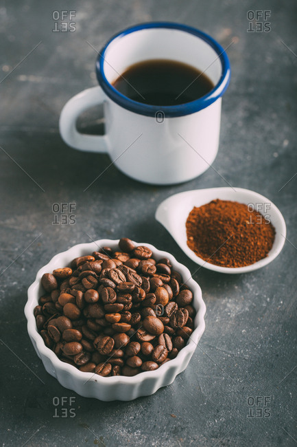 Coffee cup with coffee beans and ground coffee