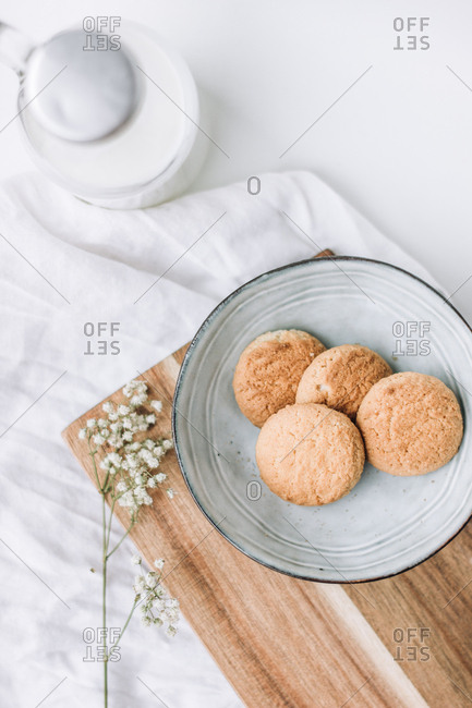 delicious cookies in a plate with bottle of milk