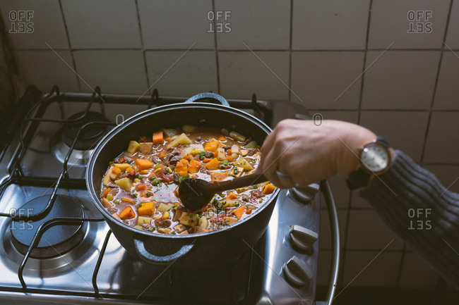 Making stew meat on pot on kitchen of home. Traditional Argentine stew