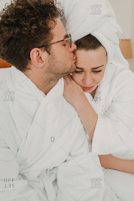 Happy couple embracing on bed