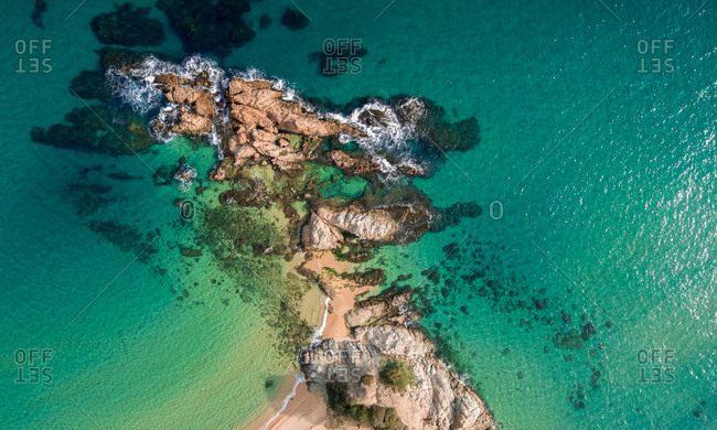 Aerial views of the rocks in the sea on a sunny day in the Costa Brava in Spain
