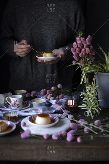 Crop woman with dessert