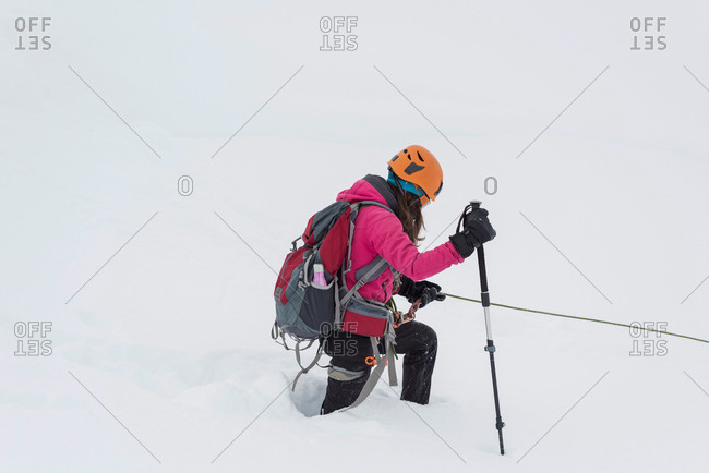 Female hiker walking on snowy region during winter