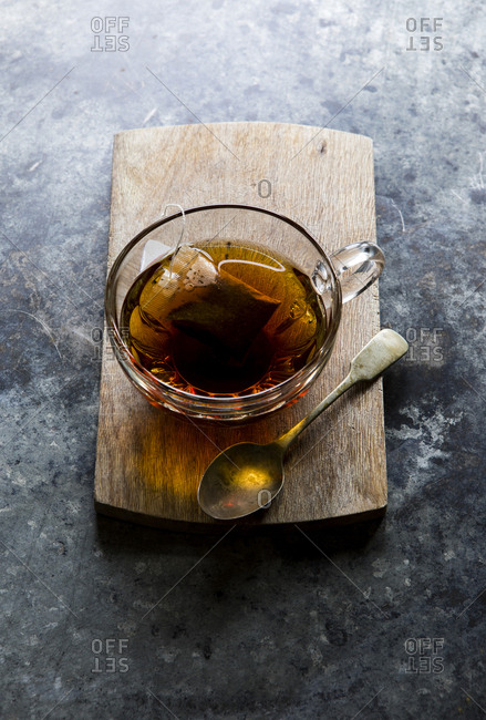 Cup of tea in a glass with tea bag