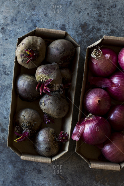Carton of onions and beetroots