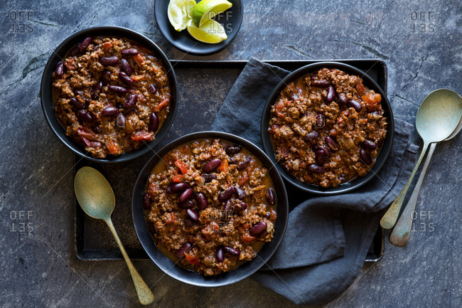 Three bowls of chili con carne