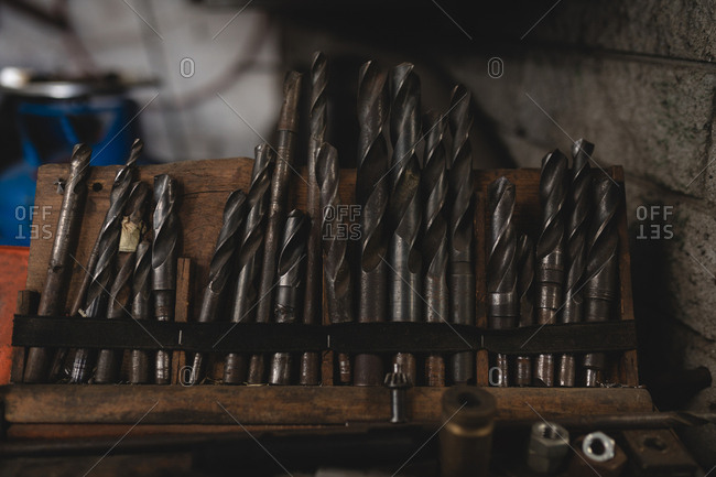 Close-up of drill bits arranged in workshop