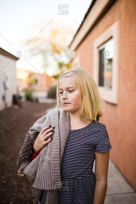 Portrait of a blonde girl with her jacket over her shoulder