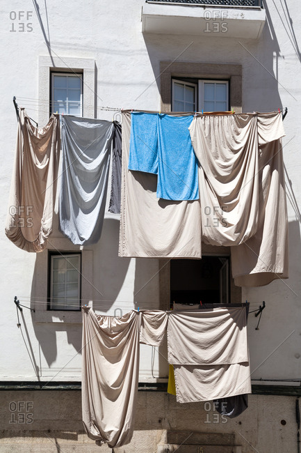Lisbon, Portugal - August 3, 2017: Laundry dries on a clothesline