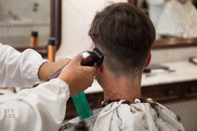 Man gets trim at the barbershop, Lisbon, Portugal