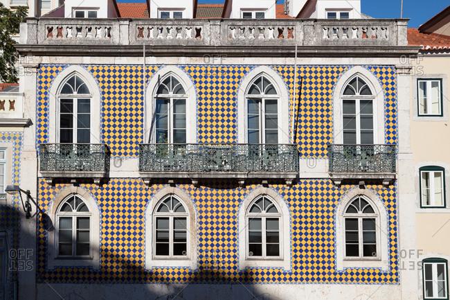 Lisbon, Portugal - August 3, 2017: Patterned ceramic tile on a building