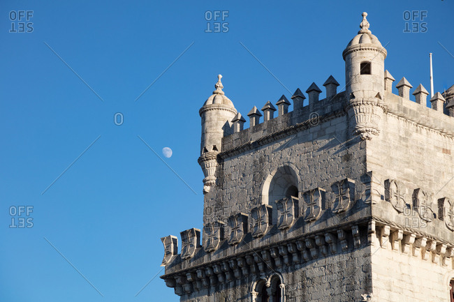 Tower of St Vincent, Lisbon, Portugal with moon