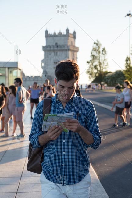Tourist studies a map, Lisbon, Portugal