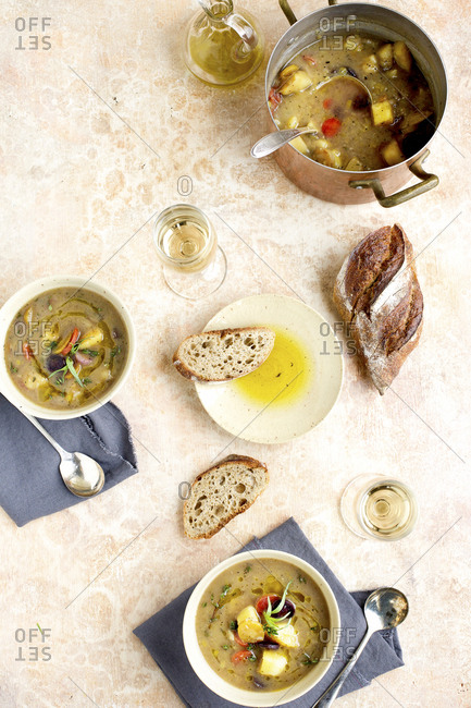 Potato leek soup with caramelized tricolor carrots served with hot pepper oil, bread and wine