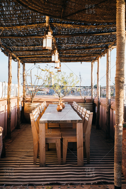 Wooden table on rooftop patio for outdoor dining