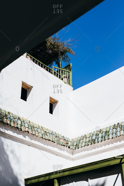 Exterior walls of white building against blue sky