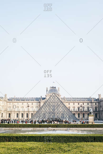 Paris, France - February 21, 2018: The Louvre Pyramid in the main courtyard of the Louvre Palace