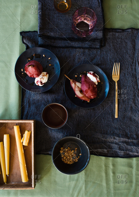 Table for two with poached pear in wine sauce