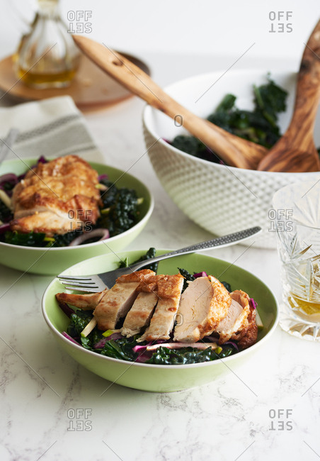 Fresh cooked chicken with kale salad for two