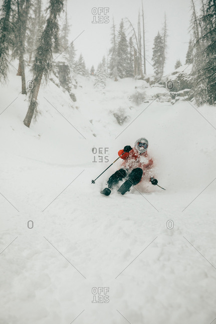 Skier skiing down a snowy hill